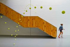 Artist Hangs 2, 000 Tennis Balls All Around Museum
