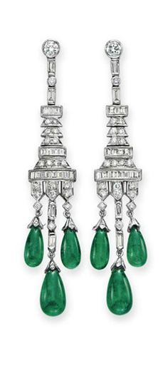 A PAIR OF DIAMOND AND EMERALD GIRANDOLE EAR PENDANTS  Each suspending three emerald drops, to the circular and baguette-cut diamond plaque of geometric motif, mounted in white gold