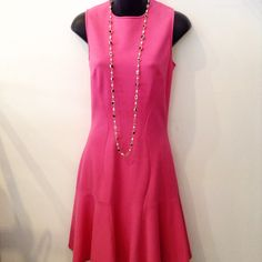 ADD SOME COLOR TO YOUR WARDROBE!  This elegant pink dress is by designer MICHAEL KORS.  Size 6 and made in Italy. Please call 949-715-0004 for inquiries.