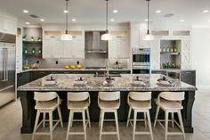 Toll Brothers - Serino Bordeaux Gourmet Kitchen Light uppers and dark lowers. T.