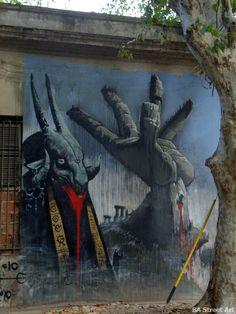 Mural de un sacerdote cabra vomitando sangre en el barrio de Belgrano en Buenos Aires, ARGENTINA