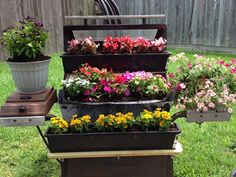 An old barbecue grill turned planter. LOVE this!
