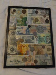 Souvenir currency arranged in a specimen frame for display.