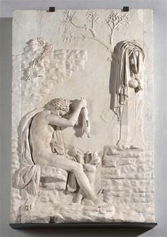 Relief, dit du Satyre chasseur. Initialement, le satyre jouait avec une petite panthère, restaurée en chien vers 1760. 1er- 2e siècle ap J.-C. Collection Albani. Paris, musée du Louvre