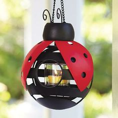 LADYBUG VOTIVE HOLDER : Sweet little miss to display three ways – use tabletop, as a wall sconce or hang from the removable chain. A votive or tealight, sold separately, will set her aglow. Weather-resistant. P91565 by PartyLite Candles