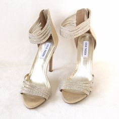 NWOT Gold Steve Madden Heels w/ Rhinestones New w/o tags. These gold heels are a showstopper! In excellent condition. There are a few imperfections on the heel and on the inside of the right heel- they are hardly noticeable. No box. Steve Madden Shoes Heels