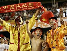 Chinese soccer fans cheer for the Chinese team in the match against Iran during the semifinal of the Asian Cup in Beijing, August 3. China beat Iran 5-4 in a thrilling penalty shootout to reach the final for the first time in 20 years.