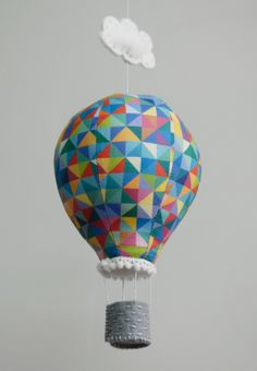 Hot air balloon inspiration.  Claire Waring has a pattern pdf for the hot air balloon for purchase.