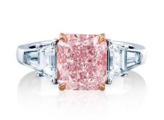 Fancy Pink Radiant Diamond Ring---A fancy pink, radiant-cut diamond is at the center of this engagement ring, flanked with trapezoid and tapered baguette diamond sides. Diamond Jewelry, Gemstone Jewelry, Diamond Rings, Pretty Wedding Rings, Pink Bling, Jewelry Trends, Colored Diamonds, Beautiful Rings, Jewels