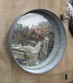 Glue a mirror to the bottom of a galvanized tub and presto rustic indoor/outdoor mirror!