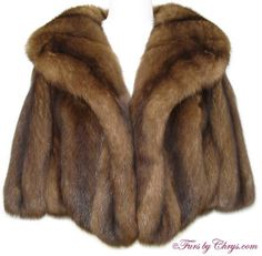 SOLD! Barguzin Russian Sable Stole #RS684; Excellent Condition; Size range: S - M - L. This is a stunning genuine natural Barguzin Russian sable stole. It has a Graf's Furs label as well as an Imperial Sable label, and features a large shawl collar. A copy of a Neiman Marcus appraisal is incl. The sable fur is very full and fluffy, and the pelts are nice and wide. It is a dramatic and elegant sable fur stole that is a very versatile piece; it will become your favorite addition to your wardrobe!