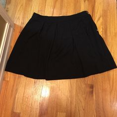 Skirt never worn no tags Pleaded Black skirt above the knee. Tommy Hilfiger perfect condition, never worn. Tommy Hilfiger Skirts Circle & Skater