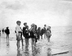 The beaches along the Dublin coastline provided leisure opportunities for Dublin families. This photograph shows children paddling in shallow water c. 1890-1910. #Irish #History