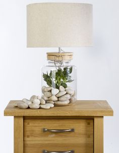 Back to Nature: Add white-wash pebbles and an artificial plant. http://blog.lauraashley.com/at-home/get-creative-the-marina-jar-lamp/