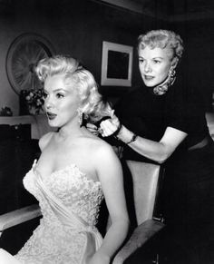 "Marilyn Monroe getting ready for the premiere of ""How To Marry A Millionaire"" 1953"