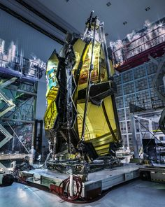 "NASA's Webb Telescope Ghostly 'Lights Out' Inspection The technicians who are inspecting the telescope and its expansive golden mirrors look like ghostly wraiths in this image as they conduct a ""lights out inspection"" in the Spacecraft Systems Development and Integration Facility (SSDIF) at NASA's Goddard Space Flight Center in Greenbelt Maryland. March 15 2017"