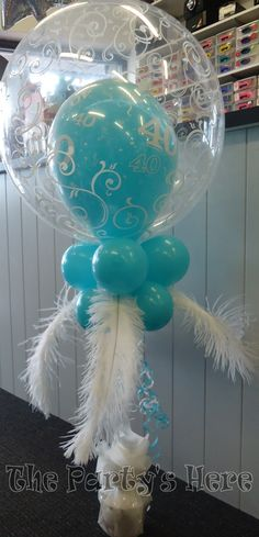 Feather Topiary Bubble for a 40th Birthday. Love Filigree bubbles & love Caribbean blue!