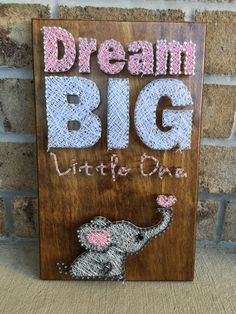Custom made to order string art board of Dream Big Little One. This custom made board would look absolutely adorable in any nursery or childs room. The size of the picture board is 10 x 16, but can custom make it to any size. Can do any color of string just ask. When ordering please specify color of string. Any questions please ask.