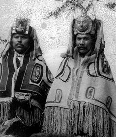 A portrait of Chief Ninstints (Tom Price, left) and Chief Giatlins (John Robson, right). Tom Price (circa 1860-1927) was the last traditional chief of Ninstints (Skungwai) to live in the village and was also a talented carver of argillite. John Robson, a famous carver, was the successor to Chief Giatlins and stepfather of Charles Edenshaw.  Studio portrait by an unknown Victoria photographer circa 1884.