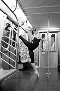 DANCE -         Beautiful ballerina dancing in the metro... strength and balance...