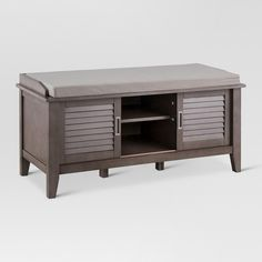 The Storage Bench with Slatted Doors from Threshold™ has it all. Whether you're sitting on it, storing things inside or displaying photos and trinkets on the shelf, this bench will be a beautiful focal point in the room. Whether you want to keep it in the entryway for a place to take off your shoes or you want to add it to your living room as a great seating option, this piece will effortlessly fit in with any existing styles.