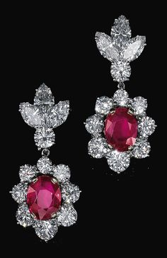 PAIR OF RUBY AND DIAMOND PENDENT EAR CLIPS, BULGARI, 1960S. Each set with an oval ruby, brilliant-cut and marquise-shaped diamonds, signed Bulgari.