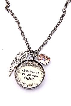"""CLICK PIC TO BUY! Breast Cancer Awareness Brave Wings Handmade necklace designed for a she going through breast cancer but could apply to many others. Vintage style gunmetal plating with a  hand glittered charm reads """"with brave wings she fights"""". Includes wing charm and vintage pale pink rhinestone dangle. 20 percent  of the proceeds go to the Susan G Komen foundation to help fight breast cancer. 18"""" Cable chain. www.nobleniches.com $40.00 #breastcancer #survivor…"""