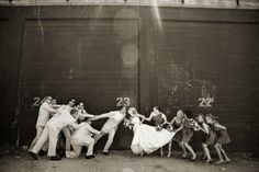 The whole wedding party gets in on the fun in the tug-of-war above.  Traditional shots are important to have, but don't ever forget to have fun!