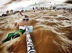 Swimmer Samir Barel, pauses for hydration / Maratón Acuática Internacional Santa Fe - Coronda  https://www.facebook.com/open.water.swimming.707/photos/a.166986560103961.37636.166974636771820/407177826084832/?type=1&theater