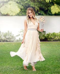 Lauren Conrad looking effortlessly beautiful in this month's @redbookmag. can we borrow those sparklers this weekend?