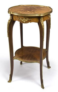 A Louis XV style gilt bronze mounted kingwood and satinwood marquetry gueridon circa 1900: