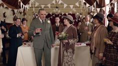 The Carsons at their wedding reception. Who is the vicar on the left? It isn't Mr. Travis.