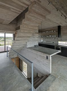 luciano kruk constructs casa golf from concrete planes in argentina