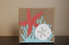 A Coral Starfish, Pool blue Coral, and a white Sand dollar boldly decorate this burlap canvas. It measures 6 x 6 x Perfect for a pop of color on a small wall or in a collage of pictures. Burlap Canvas, Diy Canvas, Canvas Art, Small Canvas Paintings, Burlap Crafts, Beach Crafts, Crafty Projects, Beach Art, Pictures To Paint