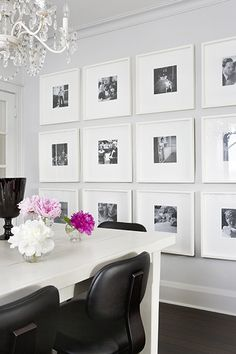 white frame all black and white pictures... wall in the dining room @Amanda Neal, what do you think???