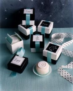 Buttons top these petit-four favors, which are set on cupcake papers, then nestled into glassine-lined black and white boxes, their lids swapped. Double-sided tape secures the ends of aqua ribbon underneath calligraphed labels. Wedding Favours, Wedding Themes, Party Favors, Wedding Ideas, Wedding Stationery, Wedding Decor, Wedding Stuff, Wedding Invitations, Paper Cupcake