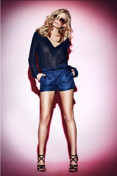 Dark blue shorts and a t-shirt. Summer stylization. Stylization for a date or a party.