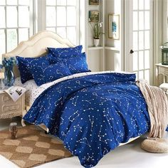 Settle for admiring the sky's wonders under your own damn roof with this constellation bedding set.