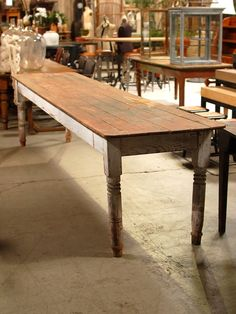 """This is a Thanksgiving Table.Wood farmhouse table with white painted legs and brown top.  12'L x 30""""W x 32""""H"""