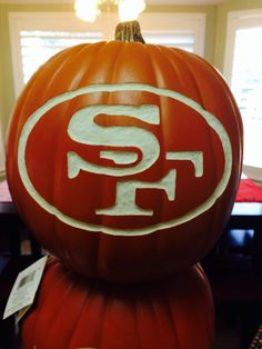 San Francisco 49ers carved foam pumpkin. I think I'd spray paint it maroon first AND THEN carve it! :)