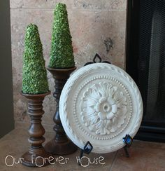 I'm so making these topiaries - candlesticks from Ikea, styrofoam tree forms, and split peas.