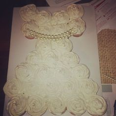My version of the cupcake wedding dress. Made with Peach Bellini cupcakes (White Cake + Champagne + Peach Schnapps)
