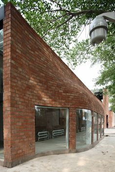 Iberia Center for Contemporary Art | Approach Architecture Studio—Beijing, China. I would like to know how this brick wall was built. It shows a new level of flexibility with the material.