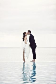 Beach wedding photo- My mom will kill me   if I get in the water with my dress on...