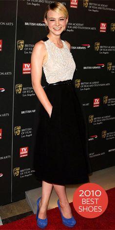Carey Mulligan wearing an A-line Preen dress with bold cobalt YSL platforms.