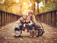 Kids in a wagon future family pictures - I know the perfect bridge to do this at! Maybe...since I have four kids...have E kinda leaning against the handle...add a soft focus...yep love it!