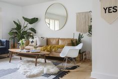 Kitchen Living Rooms Our oversized Metal Framed Mirror and Hamilton Leather sofa spotted in this light, bright living room of Erin Barrett! Seen on Apartment Therapy. - It's like a little bit of Palm Springs in South Carolina. Big Living Rooms, Living Room Mirrors, Living Room Furniture, Living Room Decor, Apartment Living Rooms, Cozy Apartment, Wall Mirrors, Country Furniture, Apartment Furniture