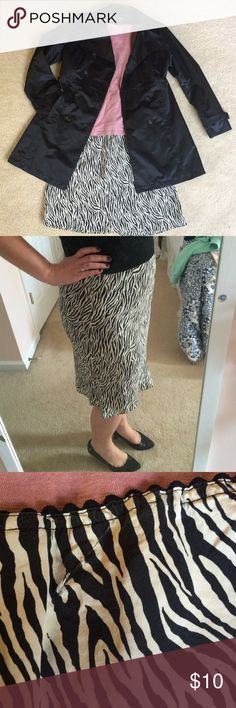NY&Co Silk Zebra Skirt 🖐🏼🚨Please see pics for one minor snag in 100% silk!! 🚨🖐🏼 this is a lovely, lightweight, flowy skirt featuring zebra print and back ric rac elastic waist. Skirt is fitted to mid thigh and has a flare the rest of the way. It was too loose at one point so I gathered and pinned it with a safety pin, resulting in the snag in the back. It's hardly noticeable and easily covered by a cardigan or untucked top. Priced accordingly to snag! NY&Company Skirts Midi