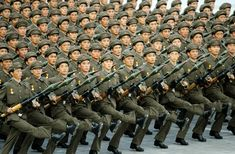 North Korean soldiers parade through Kim Il Sung Square in Pyongyang, North Korea, Tuesday, Sept. 9, 2008.