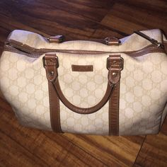 Gucci Boston large  cream and brown Gucci Boston large has stain from rubbing on jeans and on top a bit leather came off . No rips or tubing expose great bag. Gucci Bags Satchels
